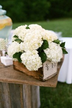 Pretty hydrangea centerpiece in a wooden box for rustic wedding decor. This is perfect, then using pops of colors with cut flowers in jars mixed throughout Wooden Wedding Centerpieces, Flower Centerpieces, Flower Arrangements, Wedding Decorations, Centerpiece Ideas, Floral Arrangement, Floral Wedding, Wedding Flowers, Chic Wedding