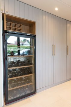 A large wine fridge sits amongst the light hues of the tongue and groove doors in this utility/ walk-in pantry. Shaker Style Kitchens, Shaker Kitchen, Large Blank Canvas, Kitchen Triangle, Shaker Furniture, Set Of Drawers, Handmade Kitchens, Bespoke Kitchens, Wine Fridge