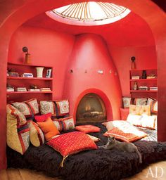 a big cozy room with pillows, a fireplace, books, and a glass ceiling? I want.