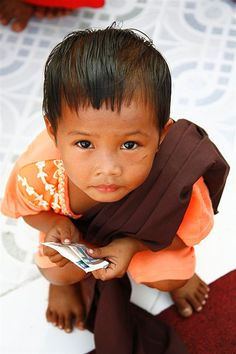 Child waiting to make a donation to the monks, Myanmar by Eric Lafforgue, via Flickr
