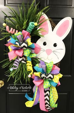 Such a beautiful Easter wreath! Our Bunny Face Easter wreath features a cute wooden bunny face.The wreath also has mixed grasses and glittery pastel picks. This wreath is built on a 24 natural oval grapevine. Easter Wreaths, Spring Wreaths, Diy Wreath, Wreath Ideas, Grapevine Wreath, Spring Crafts, Easter Crafts, Easter Ideas, Bunny Crafts
