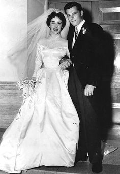 """Elizabeth Taylor    In 1950, Liz Taylor took her first trip (of seven) down the aisle, marrying hotel heir Conrad """"Nicky"""" Hilton in a Hollywood ceremony. Her silk, basque-waisted gown cost a then-staggering $ 1500 (almost $ 14,000 in today's dollars) to make and was a gift from her studio, MGM."""
