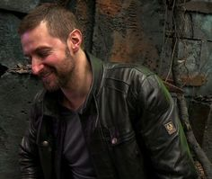 How about a shy smile from a happy hunk in leather?