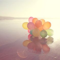 #Balloons floating in #water . Such a cool #picture .