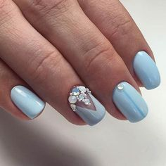 Triangle-d Aerospace Nails. A simple way to upgrade your nails with something perfect and In fashion. Draw a triangle with the pastel blue, stud it up and spark in summer sun!