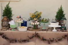 fun rustic table scape. I love the green and white cake stands (and tree cookies, and everything else)
