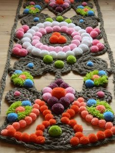Pompom rug - prefer the look of the one I pinned ages ago. That said to back with cardboard but then not washable.