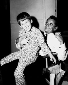 Glenn Ford horses around with Ronnie Howard on the set of The Courtship of Eddie's Father, 1962.