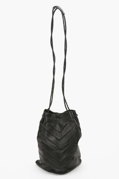 "Tryst Bucket Bag. Black lambskin leather bucket bag featuring geometric flap detailing and thin braided crossbody straps. Fully lined interior with zip pocket. Triangle bottom, comes with dust bag. By Collina Strada. *100% Genuine Lambskin Leather *10"" width *11"" height *10.5"" depth"