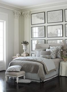 Luxe grey and white bedroom with frame wall decor.