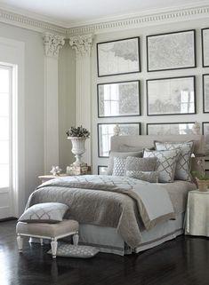 Luxe grått och vitt sovrum med ram väggdekor.