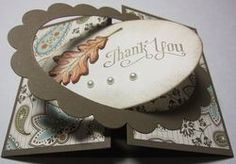 I like the way this card opens, with the oval glued to one side, and the scalloped edge glued to the other side.