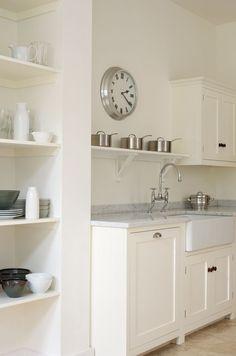 Classic English painted kitchen, white granite worktops