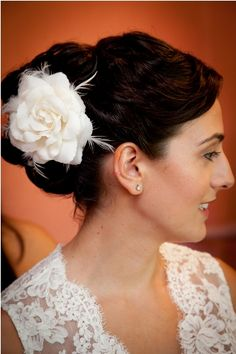 Elegant updo with rose and feather accent, modern classic! #realwedding