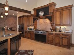 Kitchen: am liking the black accents on the cabinets