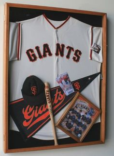 love the 'frame within a frame' idea for Justin's baseball jersey shadow box