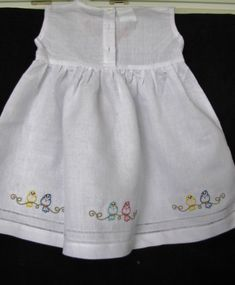 Oh so sweet! This embroidered Linen dress is adorable. Embroidered Perching Bird Line adds a touch of color and cuteness. Beautiful Linen dress with hemstitching along the bottom. The dress closes in the back with buttons as shown in picture 2. The dress is 55% Linen and 45%