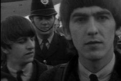 George was never a fan of the insanity of Beatlemania. Here it's clearly written on his face.Next to him is Ringo.
