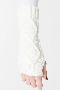Wrap yourself in warmth with these plush, diamond knit arm warmers. Wear alone or pair with your favorite gloves for extra coziness on cold days. Available Colors: Black Ivory One size fits most Fabri