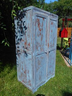 Found out at the curb on garbage day, I painted this antique wardrobe in Miss Mustard Seed's dried lavender and distressed it to give it a country kitchen feel.