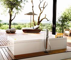 Coolest Hotel Bathtubs: Molori Safari LodgeMolori Safari Lodge knows how to pamper its guests. Five suites have a floor-to-ceiling retractable glass wall, a saligna-wood deck with an infinity pool, and, in the Metsi and Molelo suites, a Philippe Starck–designed rim-flow tub that looks out at Madikwe Game Reserve.