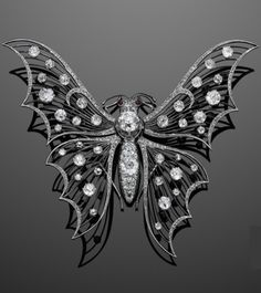 A Belle Époque platinum and diamond en tremblant butterfly brooch, circa 1910. Large delicate platinum wirework diamond-studded wings set en tremblant to the old mine diamond body of the butterfly, set with a total of approximately 14 carats of old mine and rose-cut diamonds, mounted in platinum, with French assay marks.
