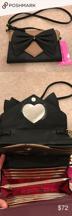 """⚡️Only Today⚡️Betsey Johnson taupe bow crossbody Brand new Betsey Johnson taupe and black bow crossbody wallet bag. Measures approximately 8"""" across and 5"""" high. Strap drop is approximately 20.5"""" and is detachable so it can be used as just a wallet as well. There's 12 cc compartments within the bag. Also it features a heart mirror and rose print lining. No Trades! Betsey Johnson Bags Crossbody Bags"""