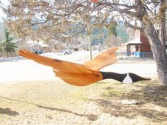 Large wooden flying bird mobile. Canada goose wood mobile. Garden decor. Home folk art decor. Wood whirlygig. by WoodaCooda on Etsy https://www.etsy.com/listing/225740797/large-wooden-flying-bird-mobile-canada