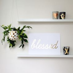 Blessed in metallic gold or silver script style font.  Beautiful addition to a nursery or living space, would make an ideal Baptism gift.Available in two sizes and two colour options.