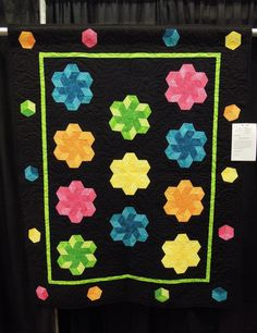 Hexagon quilts are making a comeback, and we've seen some inspiring modern variations. Tumbling blocks are hexagon shapes made with three d...