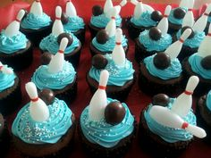 Boy Bowling Birthday cupcakes!!    We used sky blue gel paste, white nonpareil sprinkles,  bowling pin toppers and a whopper for the bowling ball!   www.layercakeshop.com