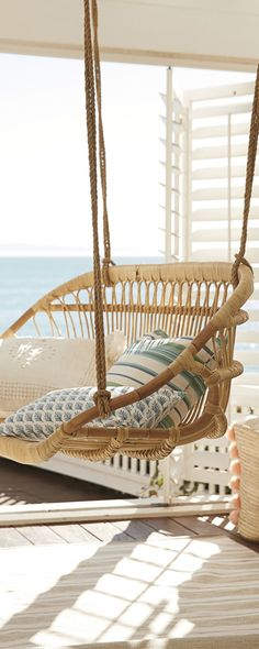 Serena & Lily Hanging Rattan Bench This relaxing rattan bench makes you feel beach-side. Its Scandinavian design gives a coastal air, and a set of throw pillows makes it undeniably inviting. Beach Cottage Style, Coastal Style, Beach House Decor, Coastal Decor, Coastal Cottage, Cozy Cottage, Coastal Homes, Coastal Living Rooms, Home Decor Ideas