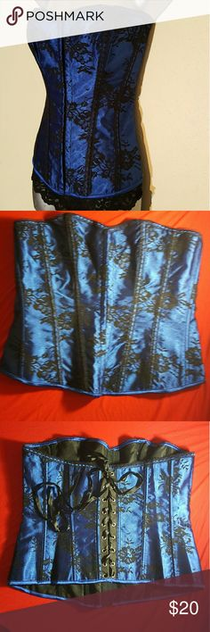 Blue with Black Lace Corset Top This gorgeous Corset has a beautiful black lace overlay with front hook and eye closure and lace up back and boning. Would look hot with a black skirt or leggings and heels! Comes with matching thong. NWOT Never worn. I used to own my own lingerie store and this is left over inventory. They tend to run small. Tops