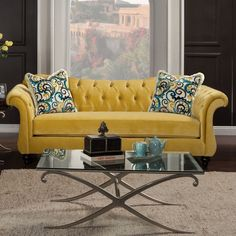 This sofa offers premium padded cushions for optimal comfort and elegantly flared, plush armrests and backs for opulent style. This living room piece is a marvelous spectacle to impress family and visitors alike.