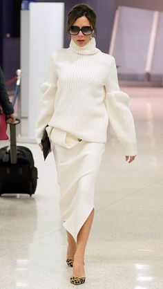 Victoria Beckham in a white turtleneck and pencil skirt