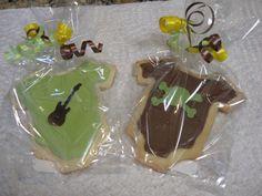 Cricut Cake.  Cookies for baby shower - used cricut cake machine to cut cookie dough onesies & to cut fondant guitar & skull/crossbones