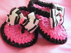 Crochet Baby Thong Sandals in Black and Hot Pink with Zebra Print Bow.