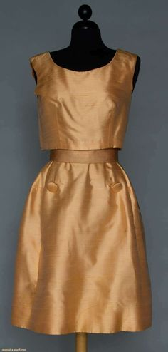 Dior New York Dinner Ensemble, 1960. Light tangerine dupioni silk skirt, bell shaped w/ attached silk under bodice, sleeveless boxy over blouse, pair large self fabric buttons on skirt F & over blouse.