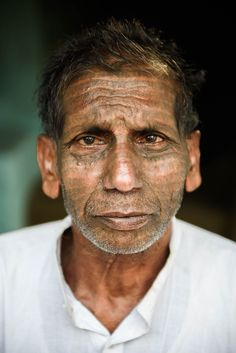 Portrait of a Ramnami man who tattooed the name of his god, Ram, all over his face to show his devotion. Some Ramnami even have their whole body covered.