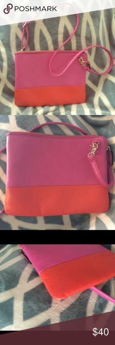 Street Level 2 Tone convertible Crossbody/Clutch Add a little extra brightness to your life with the cute hot pink and orange crossbody bag. One slight imperfection on one corner as shown in photo 3.  Removable strap easily and quickly converts to a stylish envelope clutch. Street Level Bags Crossbody Bags