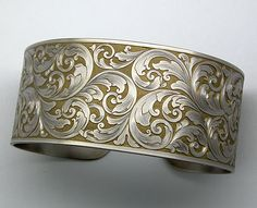 Example of bracelet with Arnaud's Hand Engraving design for a Bracelet with Scrolls