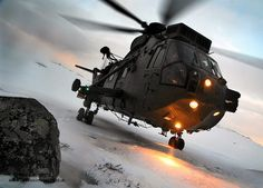 A Sea King HC Mark 4 helicopter from Commando Helicopter Force (CHF) conducts landing drills in the snow at Bardufoss, Norway.  #photo #armedforces #military