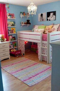 Cute Toddler Girl Bedroom Ideas : love the bed with curtains underneath. love the way the books are displayed too.