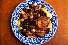 Classic French stewed chicken recipe, with bacon, mushrooms,  and pearl onions.  From Julia Child.
