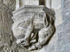A cul-de-lamp depicting a donkey using tools at the Palace of the Popes at Avignon, France / May