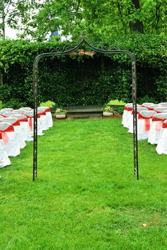 Wedding Decor- Outside Wedding with Black Alter, White Chair Covers with Pink Bows