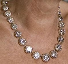 Queen Elizabeth, Queen Mother's Diamond Collet Coronation Necklace. In 1937 George VI gifted his wife, Queen Elizabeth, Queen Consort this Diamond Collet Necklace for the occasion of their coronation. Necklace was comprised of 40 brilliant cut diamonds & was a favorite of The Queen Mother's. Upon her death necklace passed on to her daughter Queen Elizabeth II. In 2007 HM loaned piece to daughter in law, HRH Camilla, Duchess of Cornwall for 60th Birthday. Duchess shortened it to 31 diamonds.