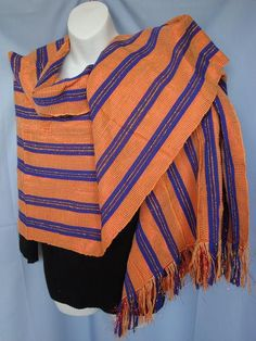 Vintage African SHAWL HEAD WRAP Hand woven and elegantly crafted in Bright Orange and Royal blue with an equivalent amount of orange/gold threads added for sparkle, this royal masterpiece will last a lifetime.    At 31 x 82, This garment is long enough to serve multiple uses.  It is made up of six 5.5 pieces that was carefully stitched to make up its width  Every cultured woman should have one of these stoked in her closet