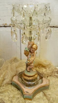 Elaborate cherub candle holder