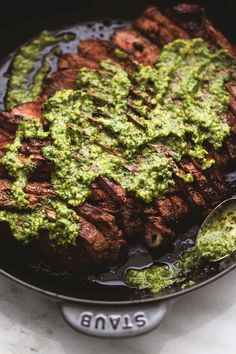 Easy Argentinean marinated flank steak with chimichurri sauce is bursting with bold savory flavors and just a hint of heat.